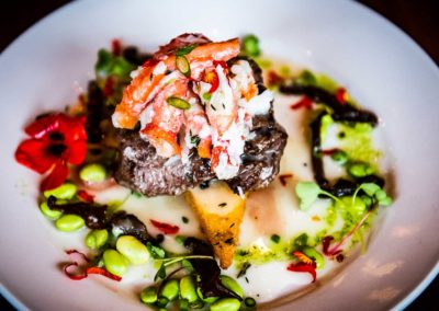 Feast bistro tenderloin served with seasonal vegetables and seafood